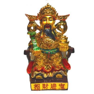 Бог богатства с золотыми слитками и жезлом